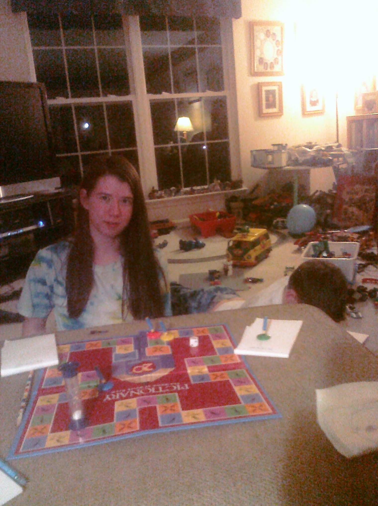 Playing a quick game of Pictionary...probably to avoid cleaning the ...